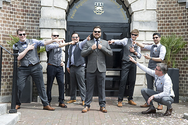 "alt=""groom and groomsmen fun photo"""